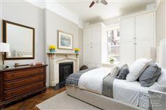 Luxury homes in striking red brick and brownstone