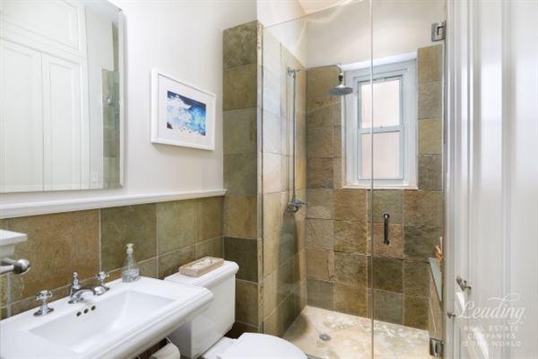 Luxury homes striking red brick and brownstone