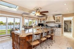 Spectacular open concept home in Paradise Point on Carlls River luxury properties