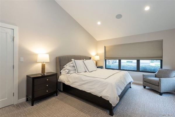 Mansions most desirable Cypress end unit with waterfront views