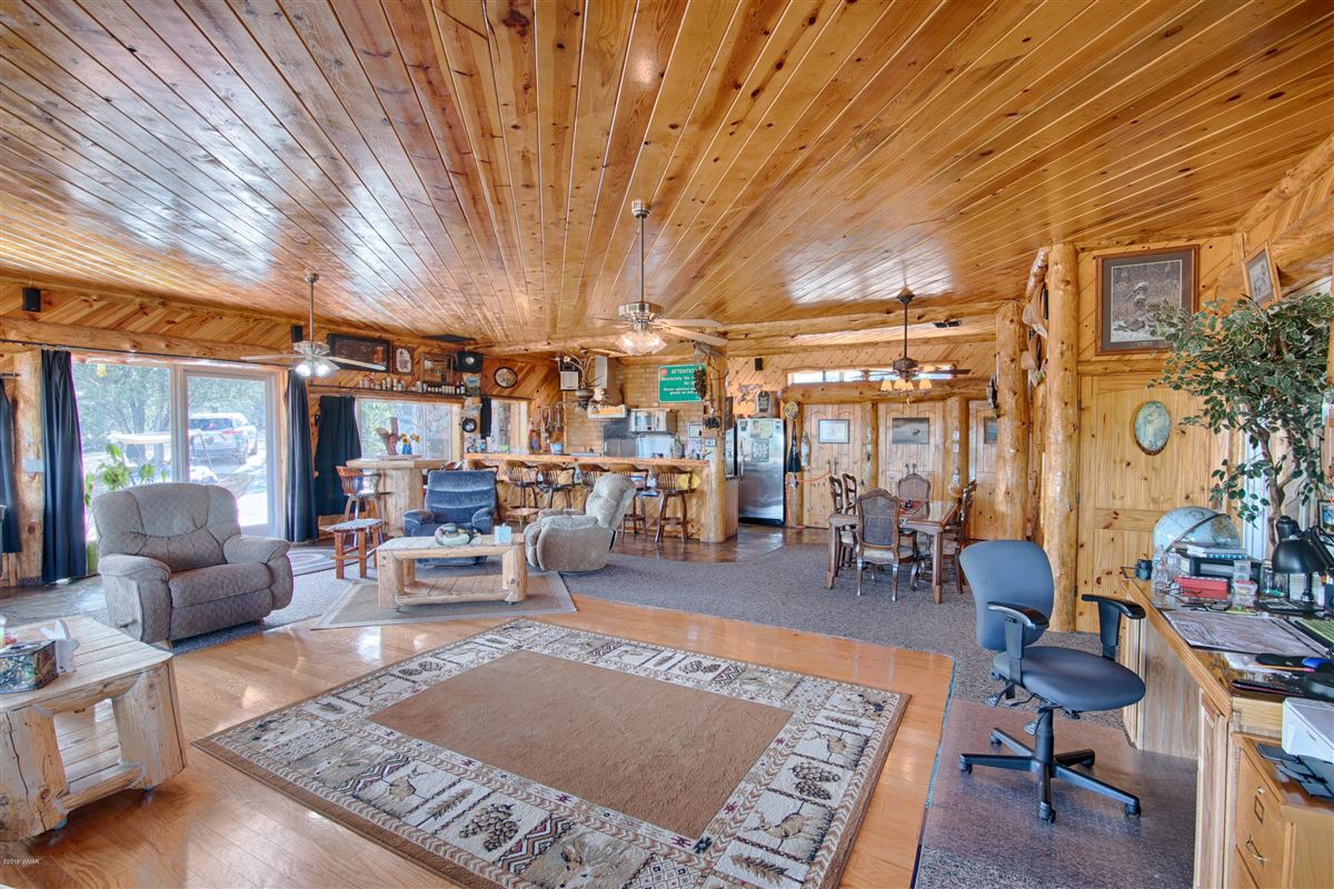 Mansions in remarkable log cabin home on 35 acres