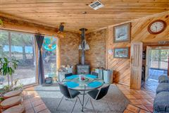 Luxury properties remarkable log cabin home on 35 acres