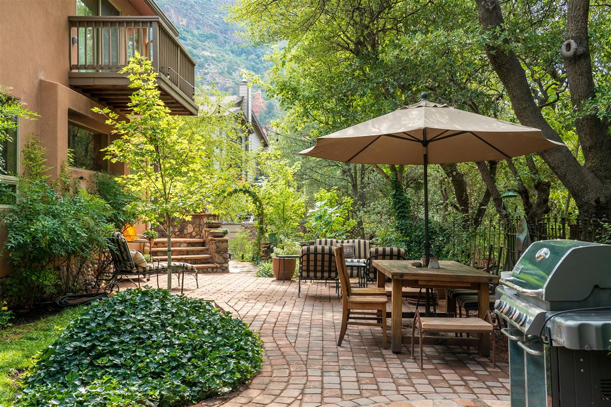 Luxury homes Gorgeous creek location offers the perfect blend of tranquility andcharm