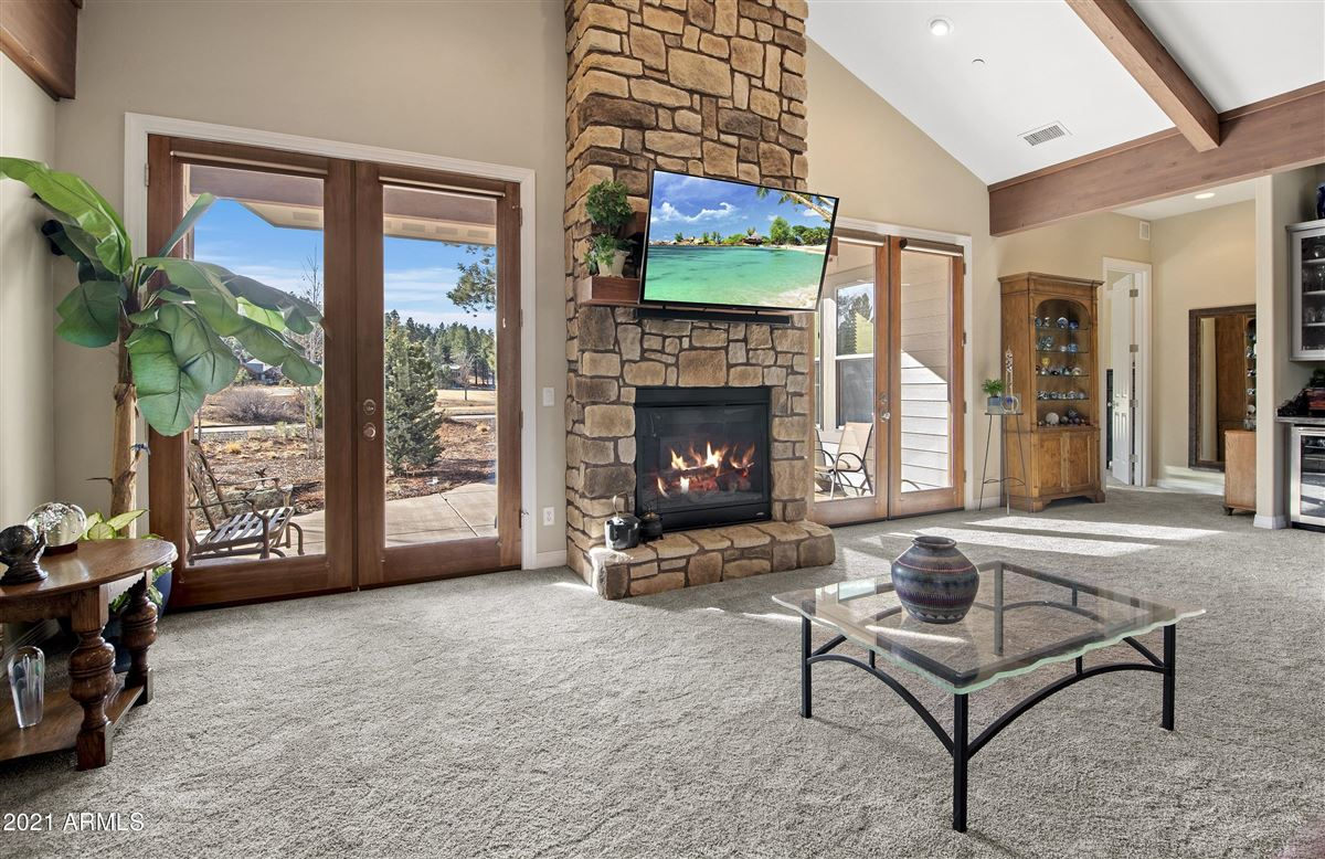Luxury homes beautiful home surrounded by lush landscaping creating privacy, mountain and golf course views