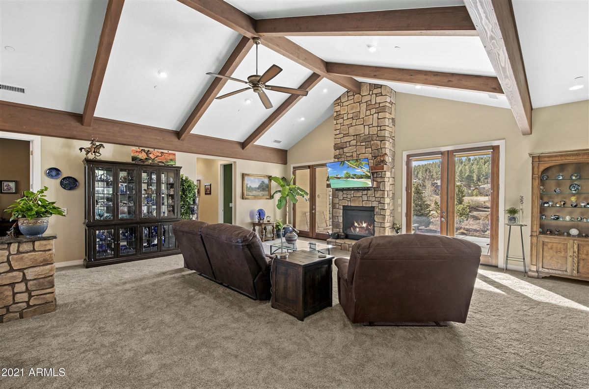 beautiful home surrounded by lush landscaping creating privacy, mountain and golf course views luxury homes