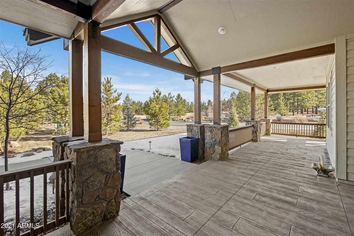 beautiful home surrounded by lush landscaping creating privacy, mountain and golf course views mansions