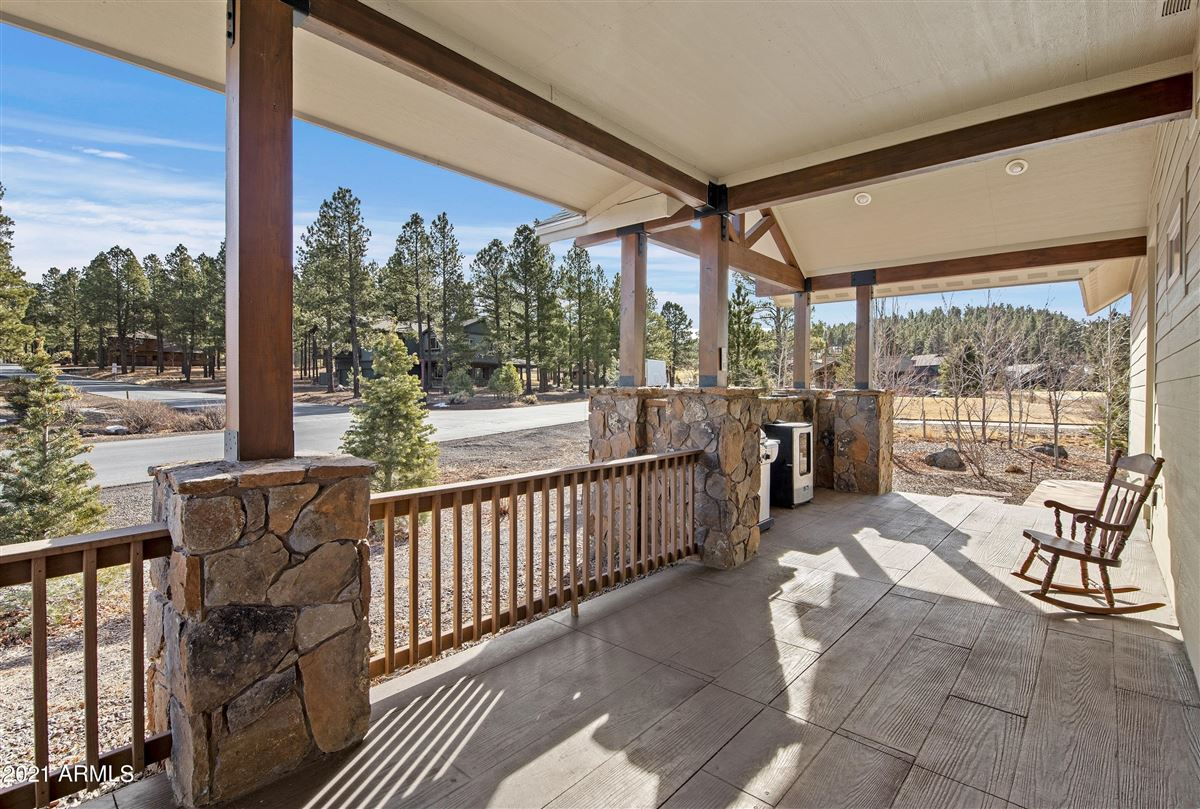 Mansions in beautiful home surrounded by lush landscaping creating privacy, mountain and golf course views
