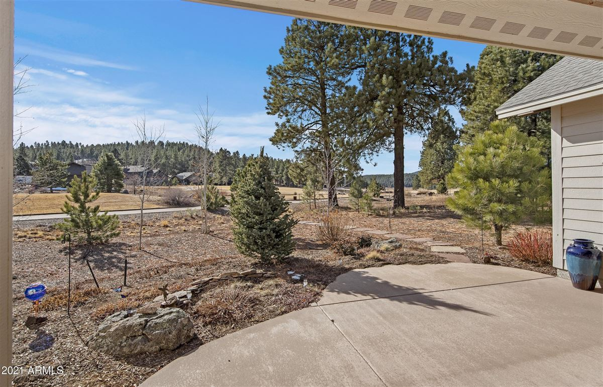 Luxury properties beautiful home surrounded by lush landscaping creating privacy, mountain and golf course views