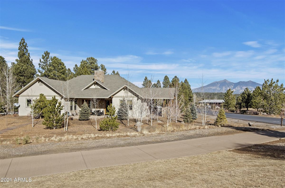beautiful home surrounded by lush landscaping creating privacy, mountain and golf course views luxury properties