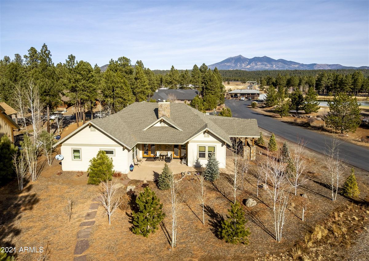 Luxury homes in beautiful home surrounded by lush landscaping creating privacy, mountain and golf course views