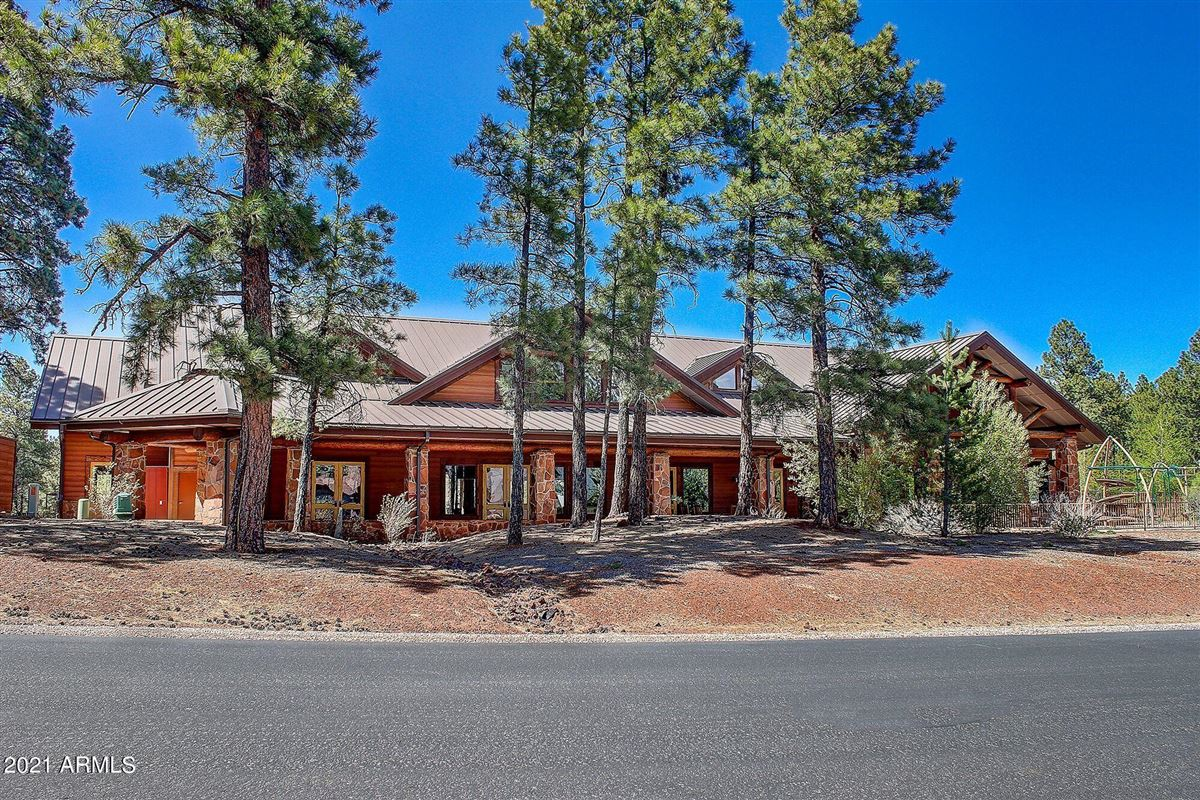beautiful home surrounded by lush landscaping creating privacy, mountain and golf course views luxury real estate