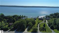 Luxury real estate no detail overlooked in this Stunning Home on Torch Lake
