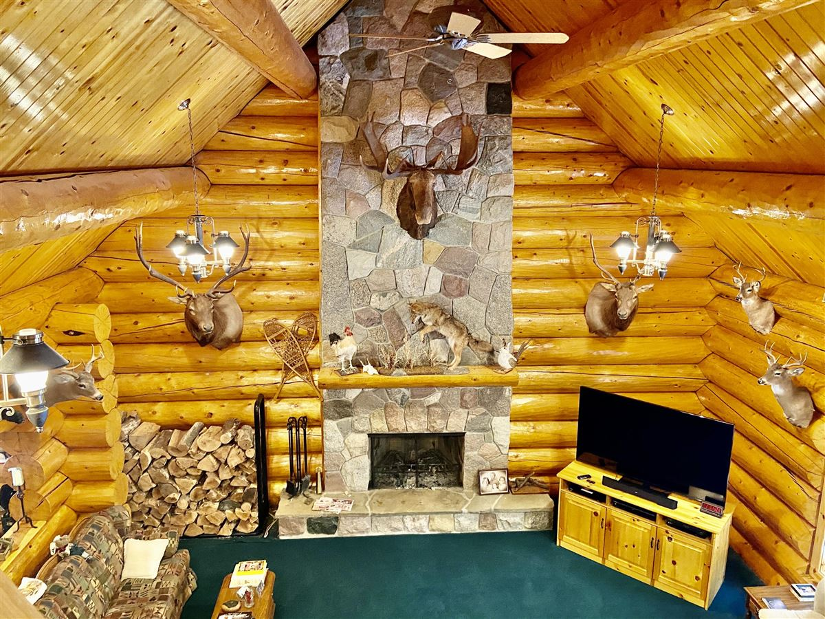 Luxury properties prestigious log home and 400 acres