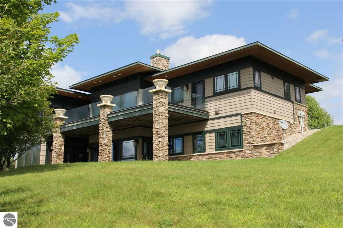 Luxury homes this Frank Lloyd Wright style home is elegantly situated