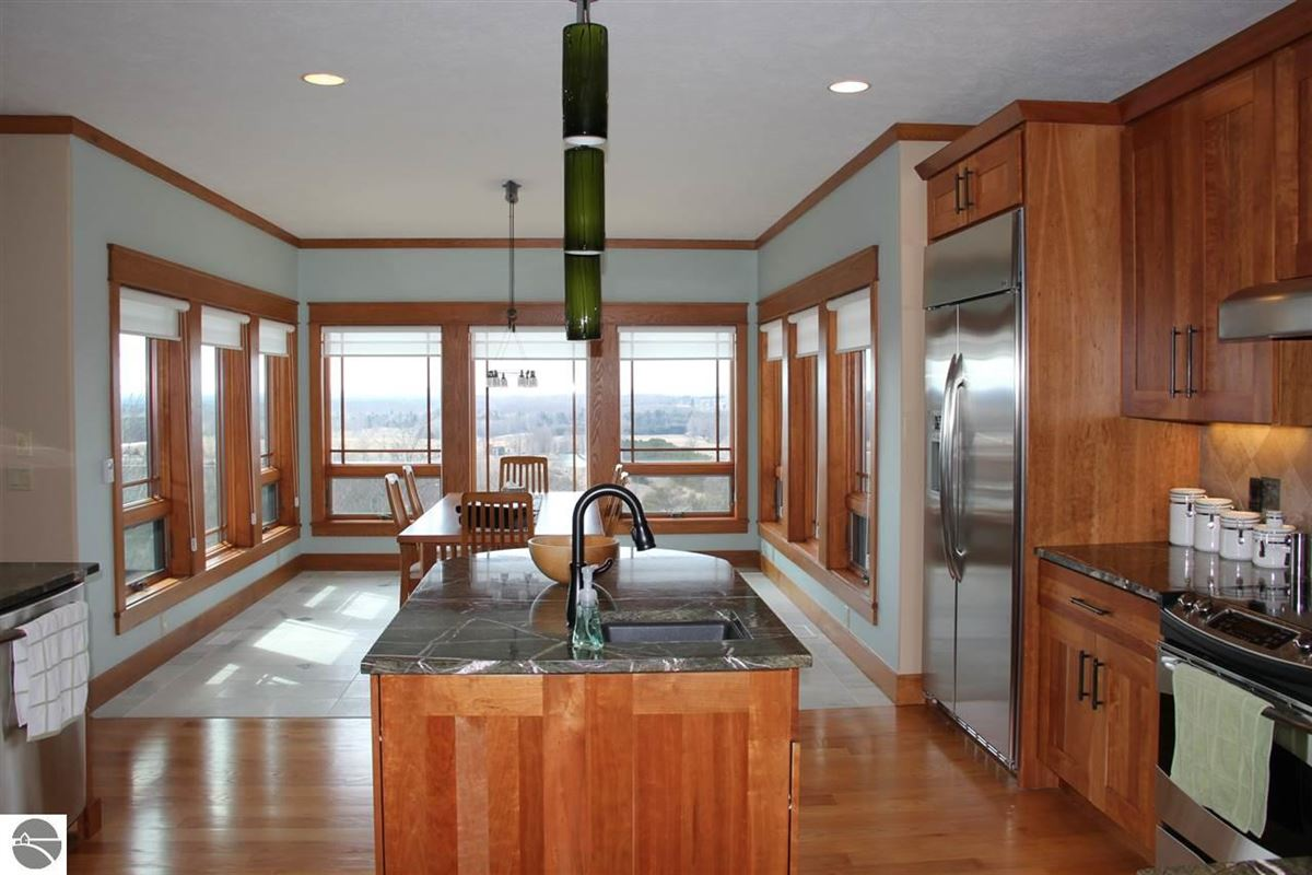 Mansions in this Frank Lloyd Wright style home is elegantly situated