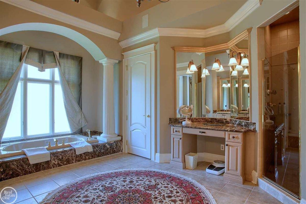 Luxury real estate custom-built home in Orchard Ridge