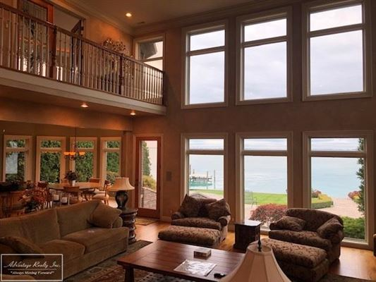 custom lakefront home with spectacular lake views luxury homes