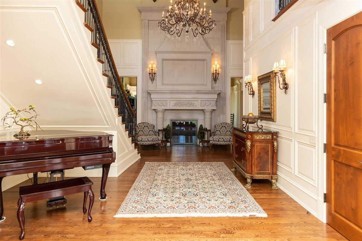 Luxury properties thoughtfully designed home with casual elegance