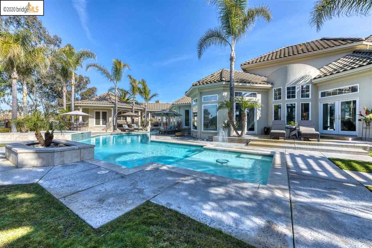Luxury properties custom estate home in Discovery Bay Golf and Country Club