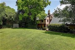 Luxury properties completely renovated Tudor style home