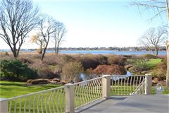 remodeled and updated spacious condo at Oyster Point offers grand waterfront views mansions