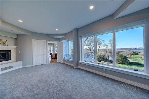 remodeled and updated spacious condo at Oyster Point offers grand waterfront views luxury homes