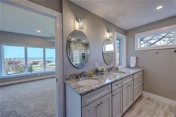 Luxury properties remodeled and updated spacious condo at Oyster Point offers grand waterfront views