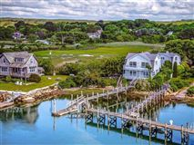 Luxury homes in two story cottage on the water