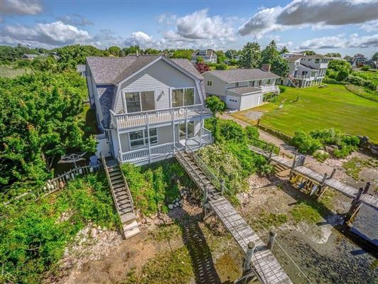 Luxury real estate two story cottage on the water