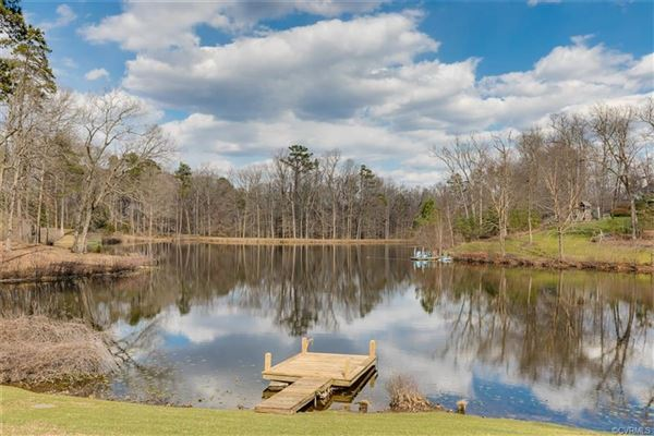 magnificent home beautifully sited on over five acres overlooking Lake Reed luxury real estate