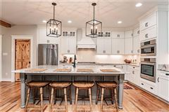Mansions in stunning near new home with wonderful custom features