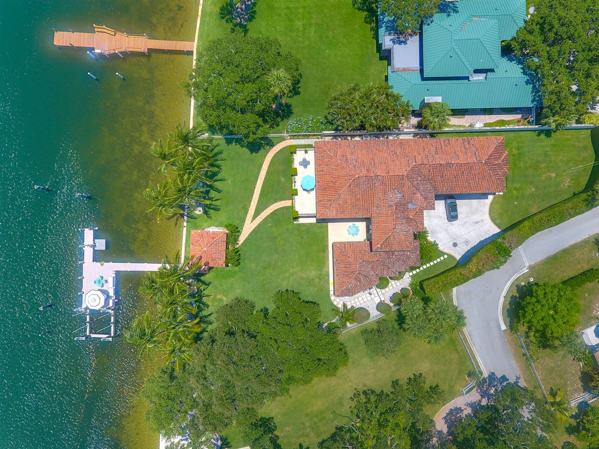Direct Intracoastal waterway Tuscan-style estate home luxury properties