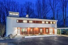 custom contemporary home on a private wooded lot luxury properties