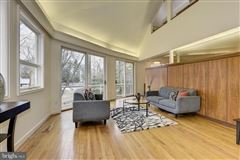 Luxury properties custom contemporary home on a private wooded lot