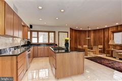 custom contemporary home on a private wooded lot mansions