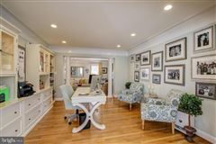 Gorgeous colonial offers a  large patio and Koi pond  luxury properties
