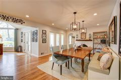 Gorgeous colonial offers a  large patio and Koi pond  luxury real estate