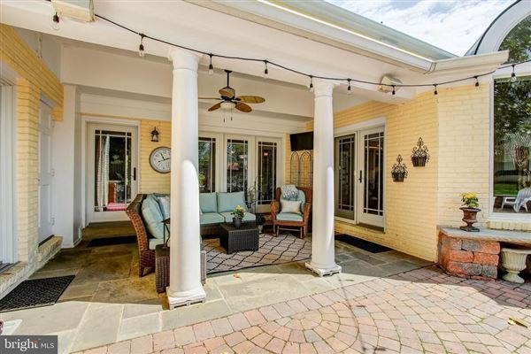Gorgeous colonial offers a  large patio and Koi pond  mansions