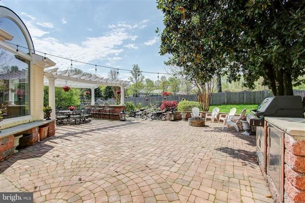 Luxury homes in Gorgeous colonial offers a  large patio and Koi pond