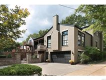 exceptional two-story Clayton Gardens home mansions