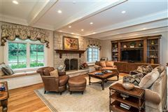 Luxury properties expanded and renovated french manor sytle home