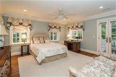 Luxury homes in expanded and renovated french manor sytle home