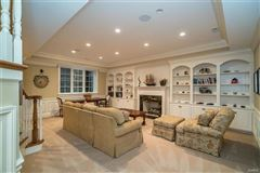 Luxury real estate expanded and renovated french manor sytle home