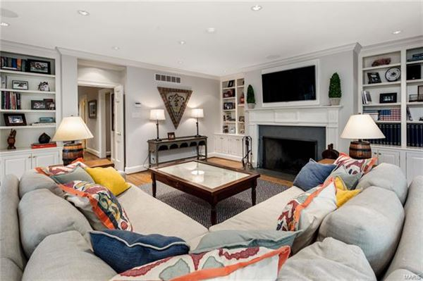 This truly exceptional home includes a cozy den and a sunroom luxury homes