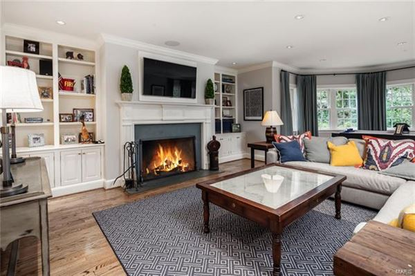 This truly exceptional home includes a cozy den and a sunroom luxury real estate