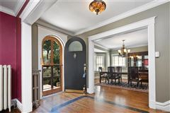 Luxury homes in classically beautiful center hall home