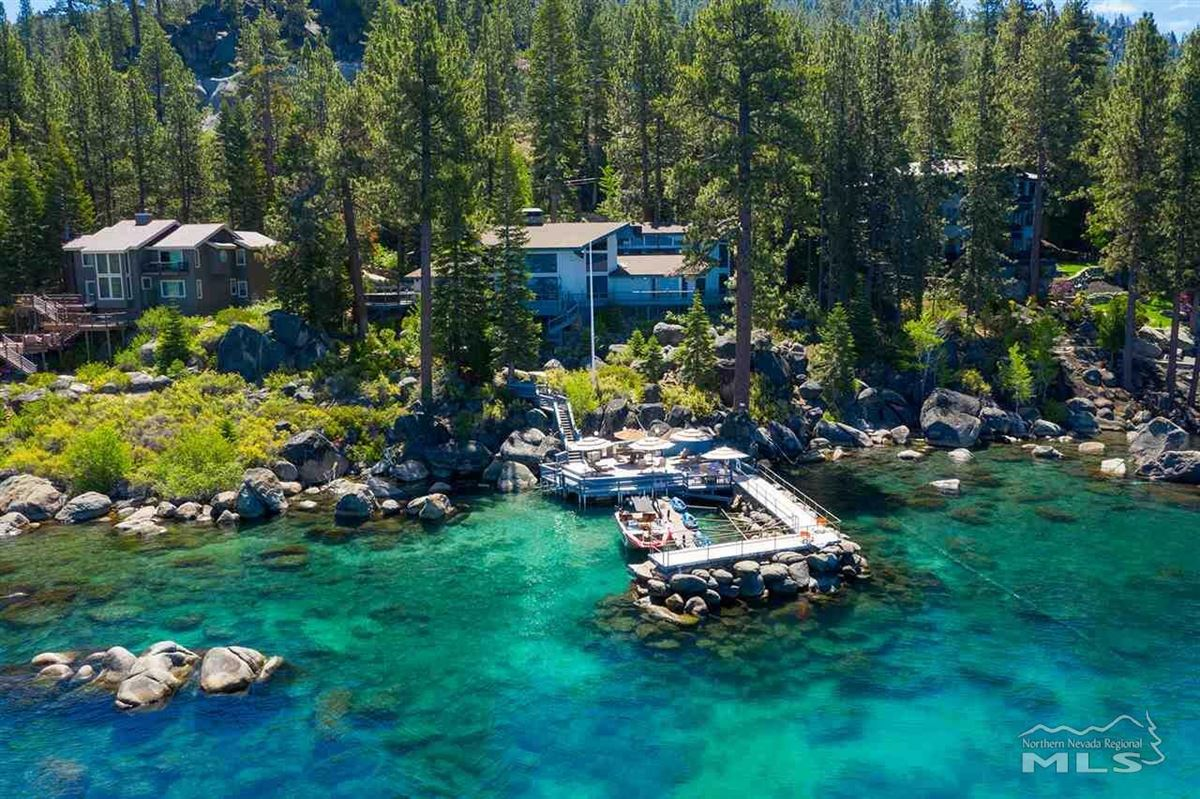 One-of-a-kind private lakefront setting luxury homes