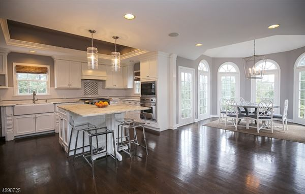 Luxury homes Commanding brick front Colonial
