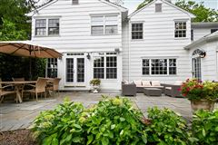 Commanding brick front Colonial luxury homes