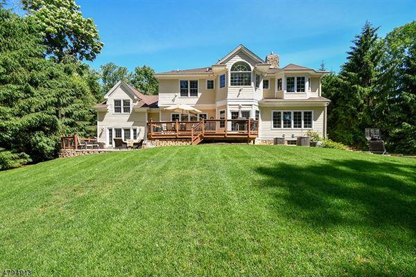 Stunning custom Colonial on lovely private acres luxury properties